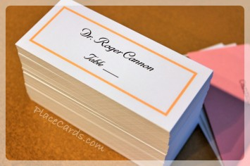 Flat single line border custom orange place cards.