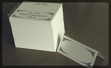 White folded place cards with charcoal grey carlson design.