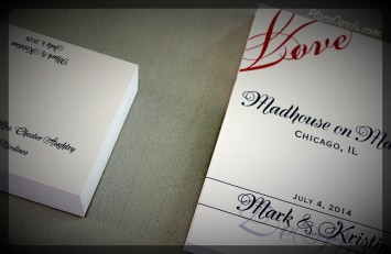 In love place cards and table cards featuring navy and red ink colors.