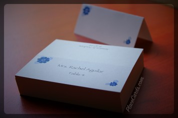 Whimsical navy flowers printed on white folded place cards