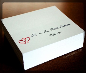 Folded place cards featuring red two hearts design.